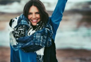 Candice Huffine looks hot in a blanket scarf.