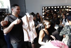 NEW YORK, NY - SEPTEMBER 15:  Micahel Costello getting ready backstage at the Michael Costello show during Spring 2016 New York Fashion Week at Pier 59 on September 15, 2015 in New York City.  (Photo by Joe Kohen/Getty Images)