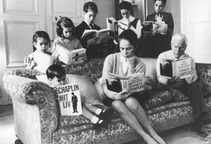 Comic actor Charlie Chaplin (1889 - 1977), his wife Oona O'Neill (1925 - 1991) and their children read copies of his autobiography in various languages, in a pose for their 1964 Christmas card picture, December 1964. On sofa, left to right: Christopher, Oona, and Chaplin. Back, left to right: Annette, Jane, Eugene, Victoria and Josephine. (Photo by Daily Express/Archive Photos/Getty Images)