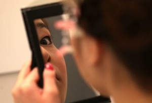 HIMEJI, JAPAN - JANUARY 13:  20 years old woman looks from mirror after finished her fitting for'Coming-of-Age Day' celebration at Hair Sakura beauty parlorl on January 13, 2014 in Himeji, Japan. The Coming of Age Day is a Japanese holiday to congratulate and encourage young people who have reached the age 20 as maturity in Japan, when they are legally permitted to smoke, drink alcohol and vote.  (Photo by Buddhika Weerasinghe/Getty Images)