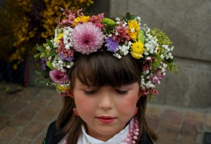 COLMENAR VIEJO, SPAIN - MAY 02:  A Maya girl wears a flowers crown during 'La Maya' tradition in the streets on May 2, 2015 in Colmenar Viejo, near Madrid, Spain. 'La Maya' festivity is a pagan tradition to celebrate the beginning of the spring which is believed to come from the medieval age. La Maya combines symbols of fertility and prosperity on agriculture and shepherding economy. A girl 'La Maya' dressed with traditional customs sits still and serious on an altar in the street decorated with flowers and plants while the rest of Mayas stand next to her and collect donations.  (Photo by Pablo Blazquez Dominguez/Getty Images)